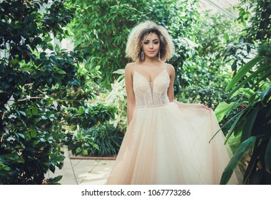 Beautiful bride outdoors in a park