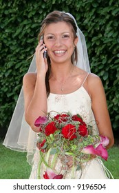 beautiful bride with phone in the wedding day