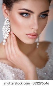 Beautiful Bride portrait wedding makeup and hairstyle with diamond crown, fashion bride model jewelry and beauty girl face, gorgeous beauty bride, isolated , studio, series.