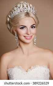 Beautiful Bride portrait wedding makeup and hairstyle with diamond crown, fashion bride model jewelry and beauty girl face, gorgeous beauty bride, isolated , studio, series