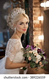Beautiful Bride portrait wedding makeup and hairstyle with diamond crown, fashion bride model jewelry and beauty girl face, gorgeous beauty bride, soft grain filter instagram like