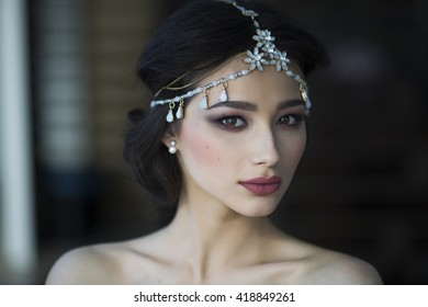 Beautiful Bride Portrait wedding makeup, wedding hairstyle, Wedding dress. Wedding decoration. soft selective focus. gorgeous young bride at home