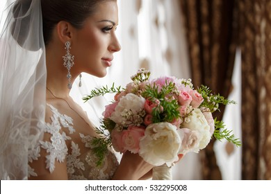 Beautiful Bride Portrait wedding makeup and hairstyle, girl in diamonds tiara, jewelry model, fashion bride gorgeous beauty, smiling happy bride woman with marriage flowers