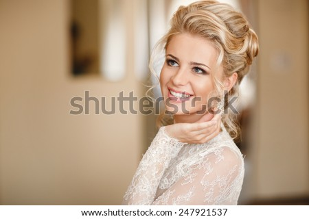 Beautiful Bride Portrait wedding makeup hairstyle, gorgeous young woman in white dress at home. series.
