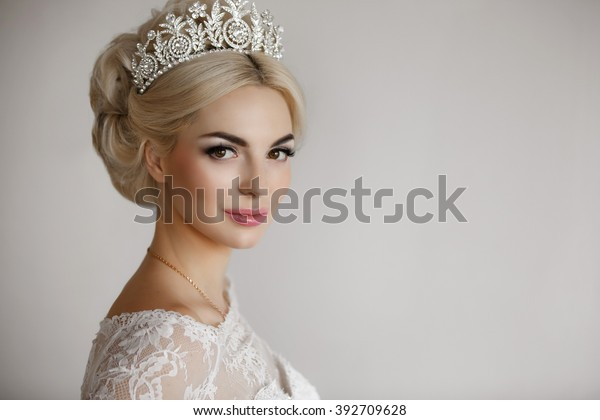 Beautiful Bride Portrait wedding makeup and hairstyle, girl in diamonds tiara, jewelry model, fashion bride gorgeous beauty, smiling happy bride woman, series