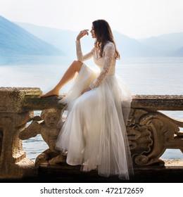 Beautiful bride posing on the coast