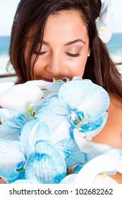 beautiful bride smelling bouquet
