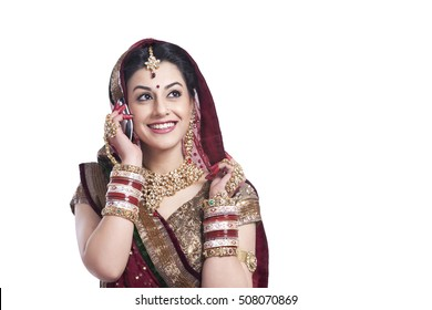 Beautiful bride talking on a mobile phone