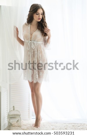 29851fea7 Beautiful bride in underwear. A picture of a young girl wear with a  transparent lace