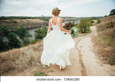 Beautiful bride walk down the aisle with bouquet.