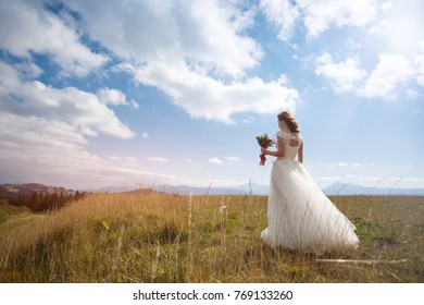 Beautiful bride for a walk in the mountains.