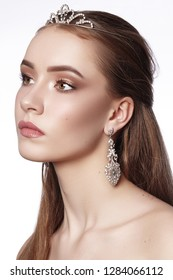 Beautiful Bride Wearing Fashion Wedding Accessories with Luxury Makeup, Hairstyle. Celebrate Make-Up. Brilliant Jewelry. Studio Photo. Young Attractive Model