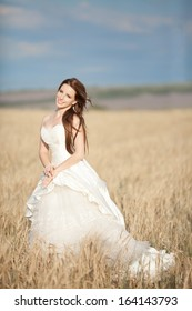 Beautiful bride at wedding day outdoor. Attractive newlywed woman in wedding dress. Portrait of bride.