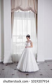 Beautiful bride in wedding dress before wedding ceremony