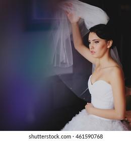 Beautiful bride in wedding dress getting ready for wedding