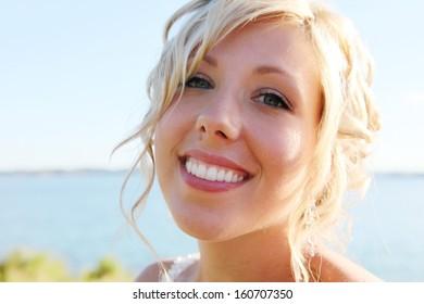 Beautiful Bride in wedding dress on sunny summer day