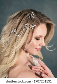 Beautiful bride with wedding makeup and fashion hairstyle. Gorgeous young woman in a white dress with a jewelry in her hair