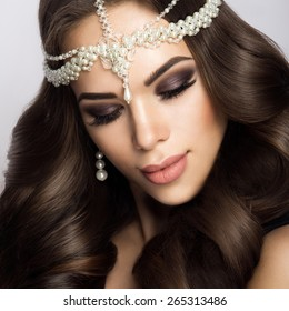 Beautiful bride with wedding makeup and hairstyle, attractive newlywed woman have final preparation for wedding.