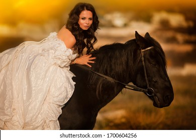 beautiful bride in a white dress on a horse