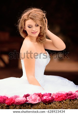 6292d8f12c1d Beautiful bride in white dress with pink and red flowers, park
