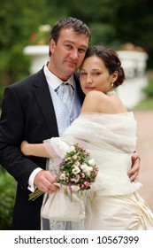 Beautiful bride in white with handsome groom on wedding day