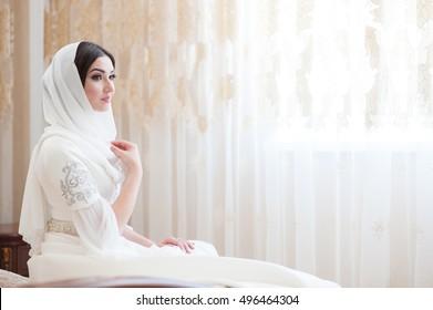 beautiful bride in white traditional muslim dress