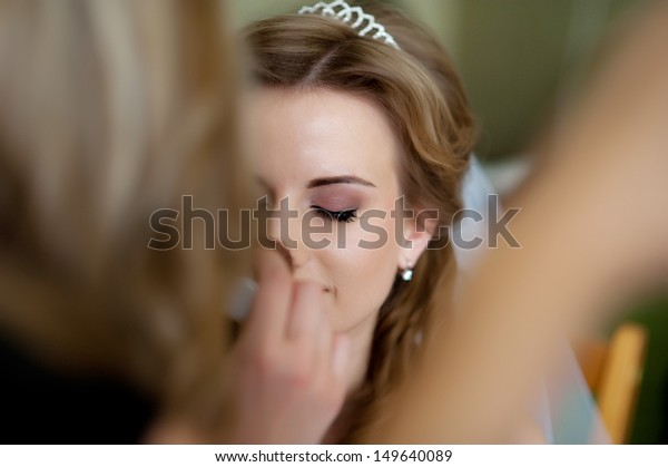 beautiful bride  in white wedding dress with hairstyle and bright makeup. Happy sexy girl waiting for groom. Romantic lady in bridal dress  have final preparation for wedding
