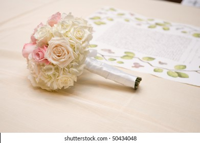 Beautiful bride's bouquet lying next to the ketubah