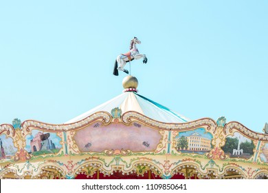 Beautiful bright carousel on blue sky background. Festival. Holiday. Carousel