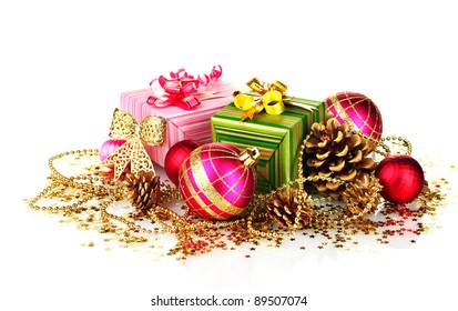 beautiful bright Christmas balls, gifts and cones isolated on white