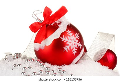 beautiful bright Christmas balls on snow, isolated on white