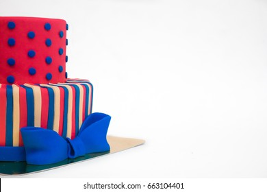Beautiful bright classy 2-tier fondant icing wedding celebration cake - isolated on white background