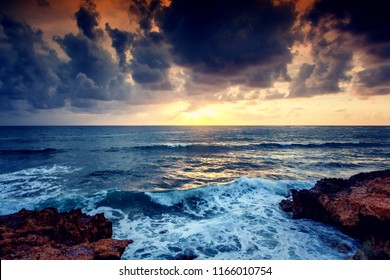 Beautiful bright colorful stunning sea sunset, rays of the sun in the clouds dramatic sunset over the ocean