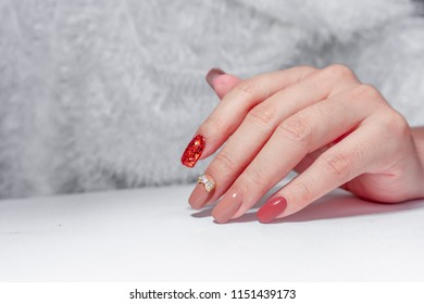 beautiful bright and dark brown gel polish on fashionista woman fingernails decorated with sparkling  glitter and cute diamond ribbon
