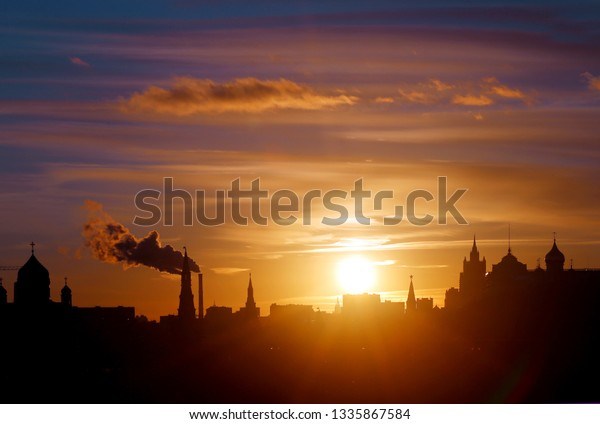 Beautiful bright landscape photo with silhouettes of the Moscow Kremlin in the evening at sunset