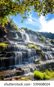Beautiful bright landscape with waterfall and green trees