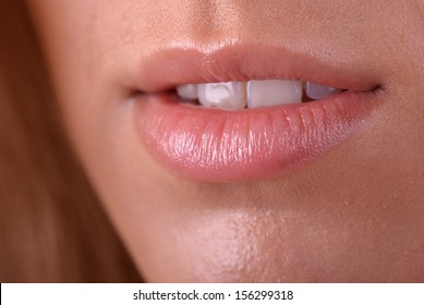 Beautiful bright lips of a young woman