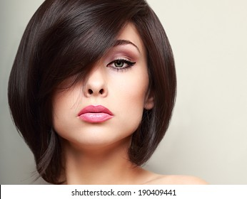 Beautiful bright makeup woman with black short hair style. Closeup