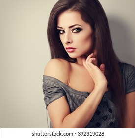 Beautiful bright makeup woman with long smooth hair style looking sexy. Toned vintage portrait with empty copy space