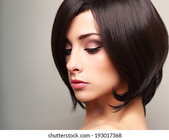 Beautiful bright makeup woman profile with black short hair