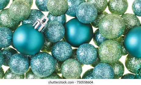 Beautiful, bright, modern Christmas holiday ornaments decorations in contemporary trendy blue and green colors with sparkling glitter on white background. Horizontal border background image.