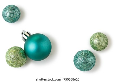 Beautiful, bright, modern Christmas holiday ornaments decorations in contemporary trendy blue and green colors with sparkling glitter on white background
