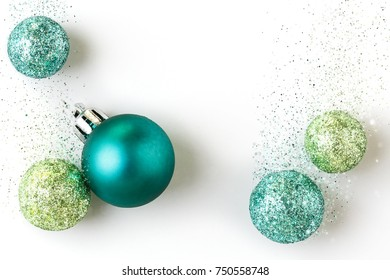 Beautiful, bright, modern Christmas holiday ornaments decorations in contemporary trendy blue and green colors with sparkling glitter special effect on white background.