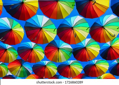 Beautiful bright multi-colored umbrellas, a symbol of summer tourism background