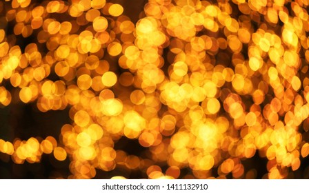 Beautiful bright photo of macro shimmering golden circles on a dark background.