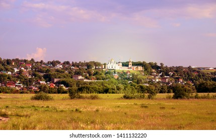 Beautiful bright photo of a summer landscape with temples in the fields