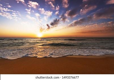 Beautiful bright purple sunrise on the ocean!