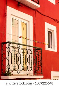 Beautiful bright red facade of the building in Lisbon, Portugal.