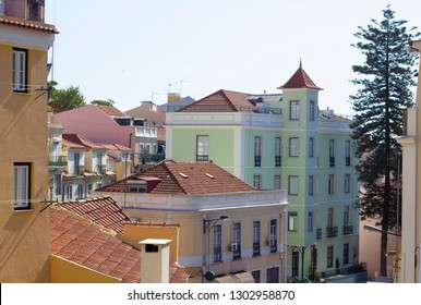 beautiful brightly painted building on the outskirts of Alfama in Lisbon, Portugal in the morning with beautiful morning light.