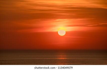 A beautiful  brilliant  orange sunset over Lake Michigan in the USA